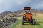 Lonely old tractor in Altai steppe