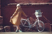 Hipster painter. Fashion blond woman with retro white bicycle street style outdoor portrait