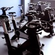 Постер, плакат: Black exercise bikes