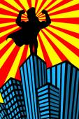 Silhouette of superhero man showing his muscles on top of skyscraper watching over the city