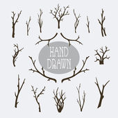 Set of hand drawn branches and trees decorative elements
