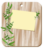 On a wooden board is a sheet for recording and pea plants Background