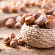 Постер, плакат: Hazelnuts on wooden background