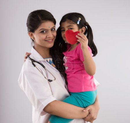 indian girl child with young beautiful female doctor