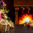 Постер, плакат: Christmas scene with fireplace and Christmas tree in the backgro