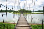 Suspension bridge above the lake, path way to forest. Kaeng Krachan national park