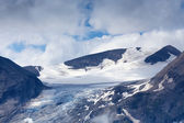 Glacier, snow and clouds in high alpine mountains