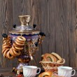 Постер, плакат: Ancient Russian samovar with a big cup of tea