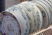 Old plates displayed for sale at second hand shop