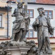 Постер, плакат: Statue of the Holy Savior with Cosmas and Damian on Charles Bridge in Prague