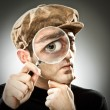 Curious man look with magnifier glass on grey background