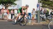 Saint Gilles Croix de Vie, France - September 10, 2016 : Final triathlon championship of France in the category D3 - Cyclists in a curve during a road bike race