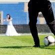 Постер, плакат: Wedding couple playing football