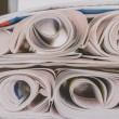 Постер, плакат: Stack of newspapers