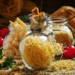 Постер, плакат: Dry Italian pasta fedelini in a glass jar