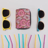 Purse, sunglasses and straws
