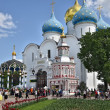 Постер, плакат: Many pilgrims and tourists gathered in the main square of the Cathedral of the Holy Trinity St Sergius Lavra