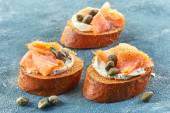 Toasted bread with smoked salmon — Stock Photo