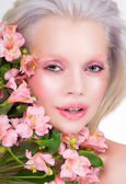 Blonde model with flowers — Stock Photo