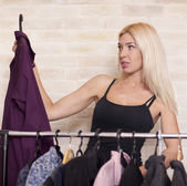 Woman looking at clothing on rail — Stock Photo