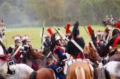Reenactors dressed as Napoleonic war soldiers ride horses — Stock Photo