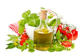 Olive oil with fresh basil and tomatoes. food background — Stock Photo