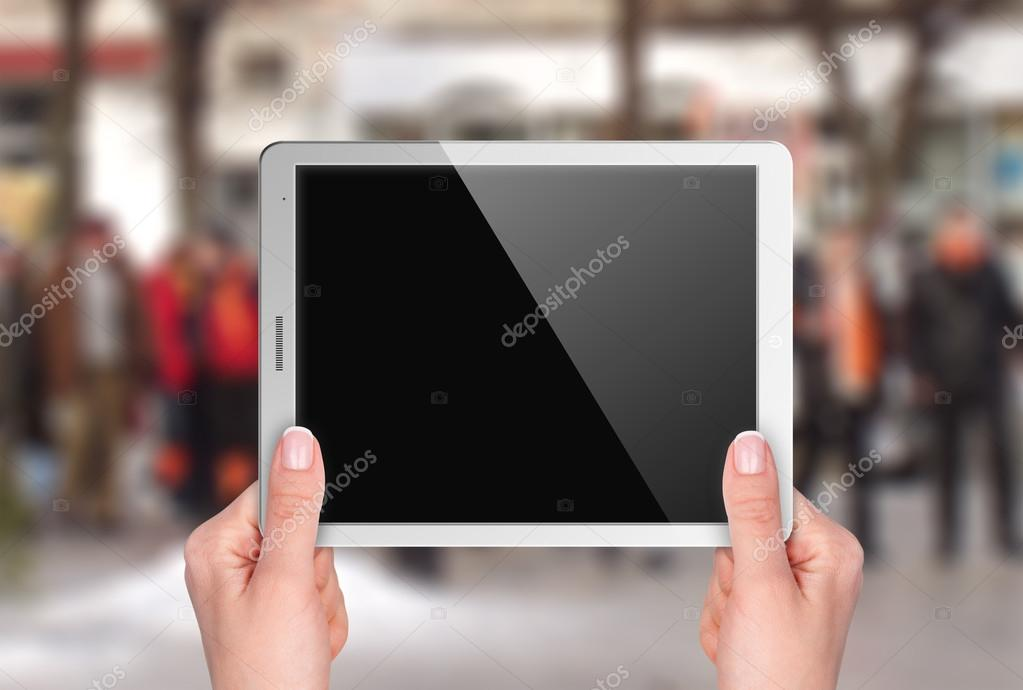 Tablet with blank screen in hand