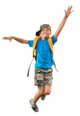 schoolchild with backpack and a cap jumping