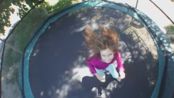 cheerful child jumping on  trampoline