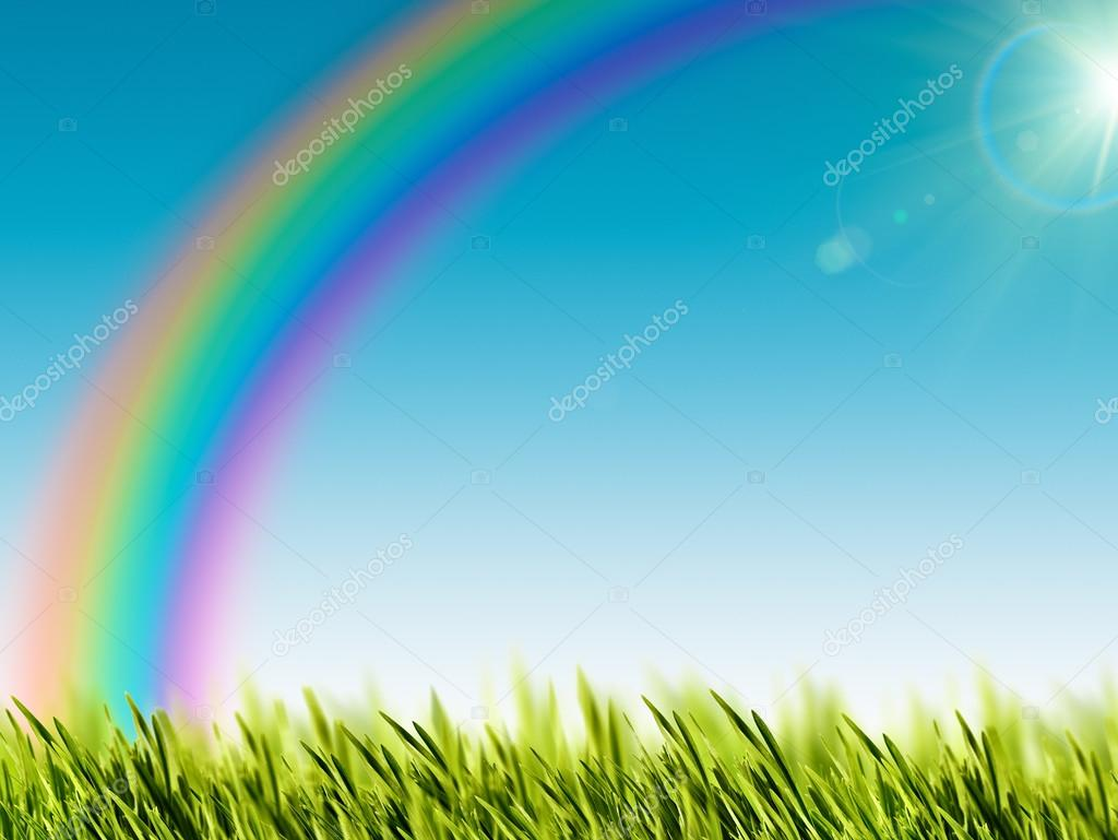 Funny rainbow over the summer meadow