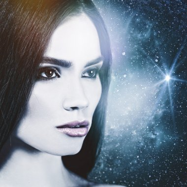 woman looks to the Universe