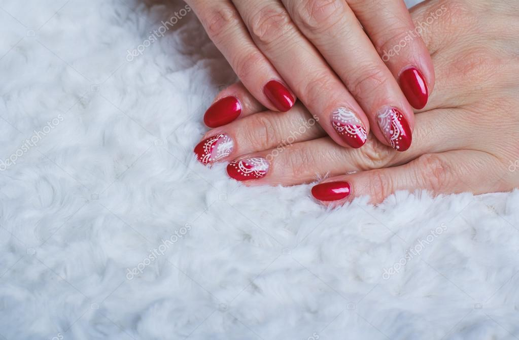 Red nail art with white lace with dots and lines — Stock Photo ...