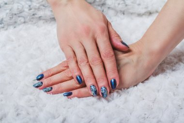 Blue nail art with white lace