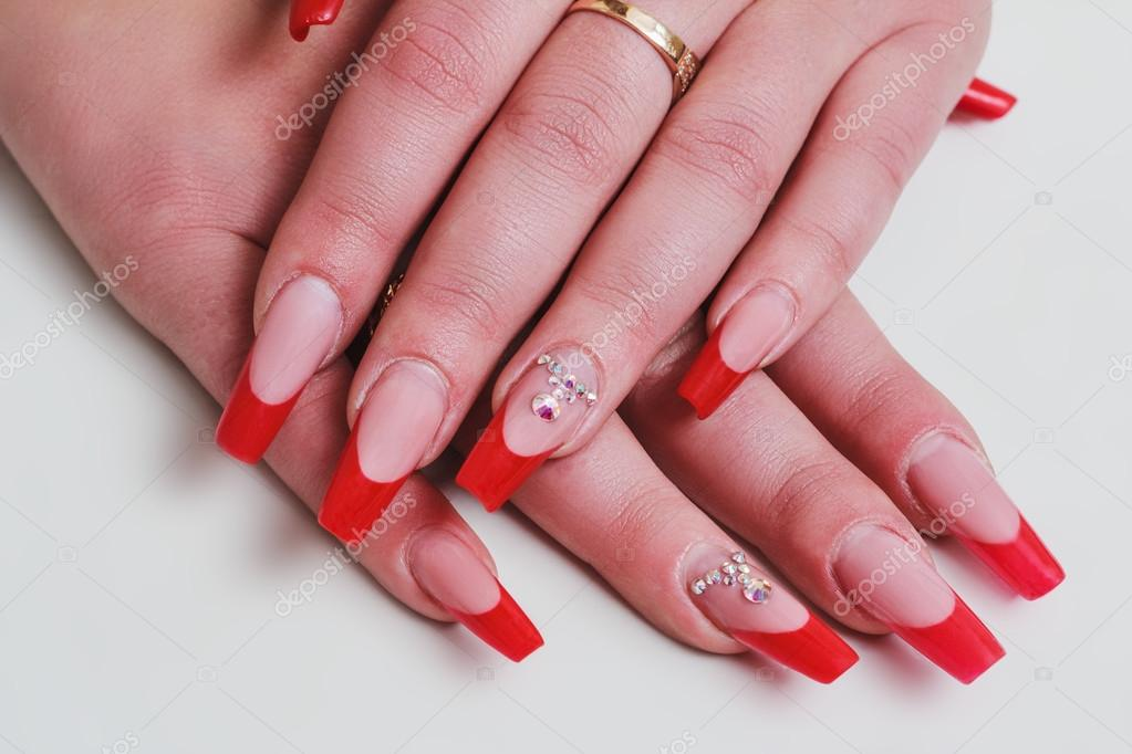 Red french nail art with rhinestones — Stock Photo © selora #87576948