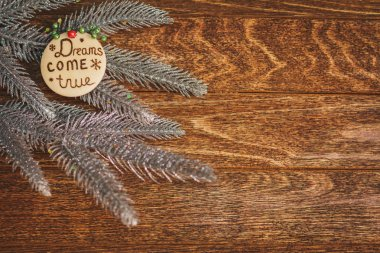 Christmas tree with burned inscription Dreams come true on wood