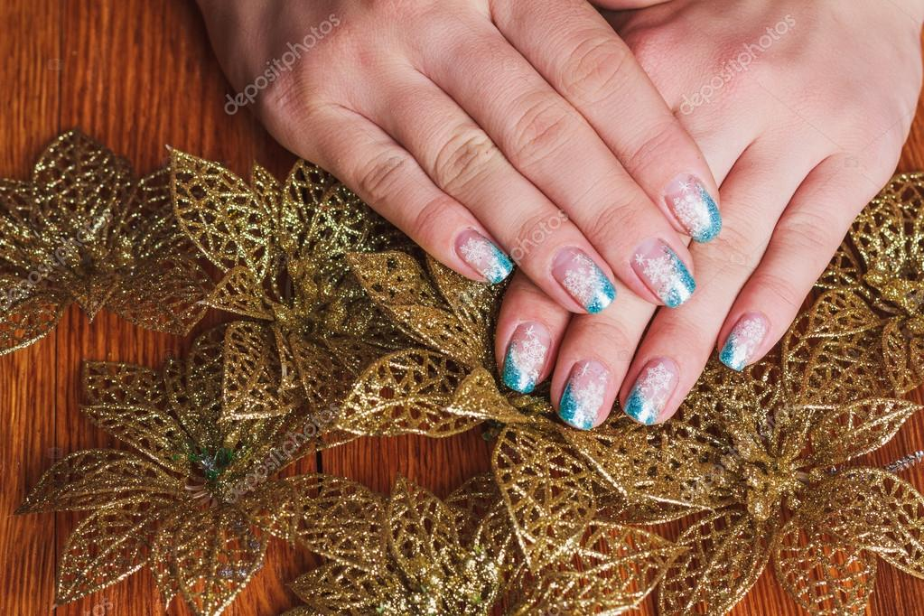 Winter Nail Art With Snowflakes And Light Blue French Stock Photo