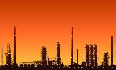 Oil chemical plant silhouette over sunset