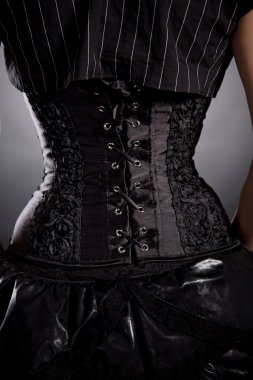Woman in black rose corset