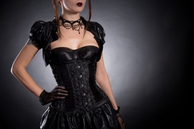 Young woman in Victorian style corset