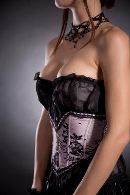 Busty woman in elegant Victorian corset