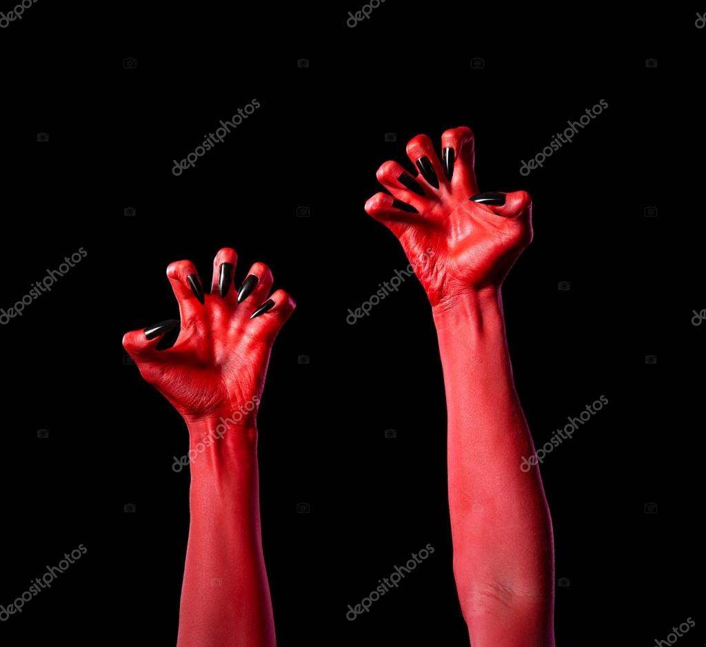 red devil hands with black nails real body art stock photo