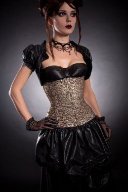 Gothic girl in Victorian style outfit and rose corset