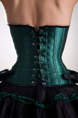 Attractive woman in green corset