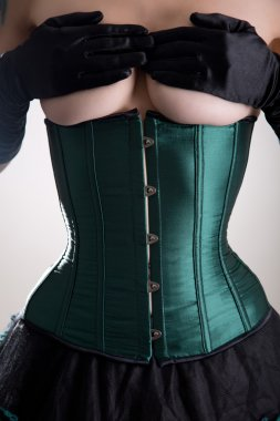 Topless woman in green corset
