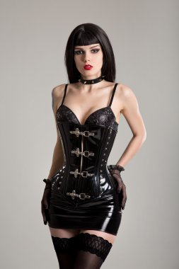 Young sexy woman in black fetish corset