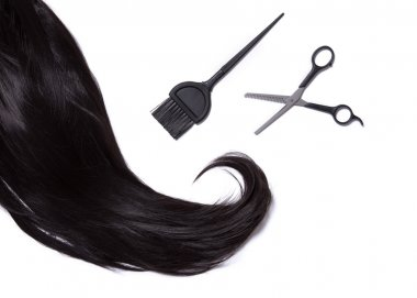 Top view on black shiny hair, hair dye brush, and professional scissors, isolated on white background stock vector