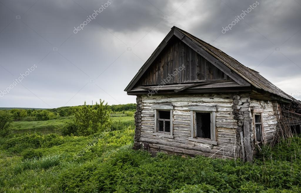 Dilapidated old village house in Russia