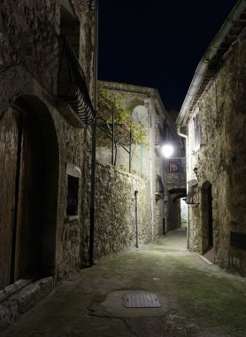 street in old town Peille at night