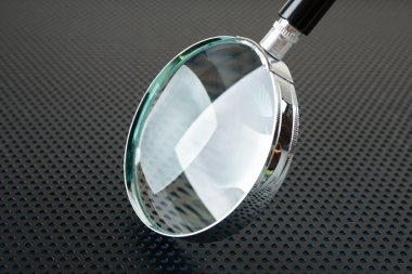 Magnifying glass on  background