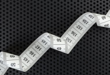 Curved white measuring tape
